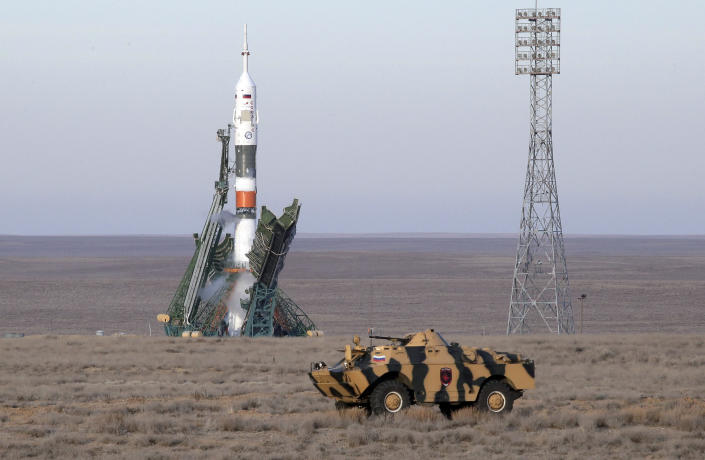 A police APC drives prior to the launch of Soyuz MS-11 space ship with U.S. astronaut Anne McClain, Russian cosmonaut Оleg Kononenko and CSA astronaut David Saint Jacques, members of the mission to the International Space Station at the Russian leased Baikonur cosmodrome, Kazakhstan, Monday, Dec. 3, 2018. (AP Photo/Dmitri Lovetsky)