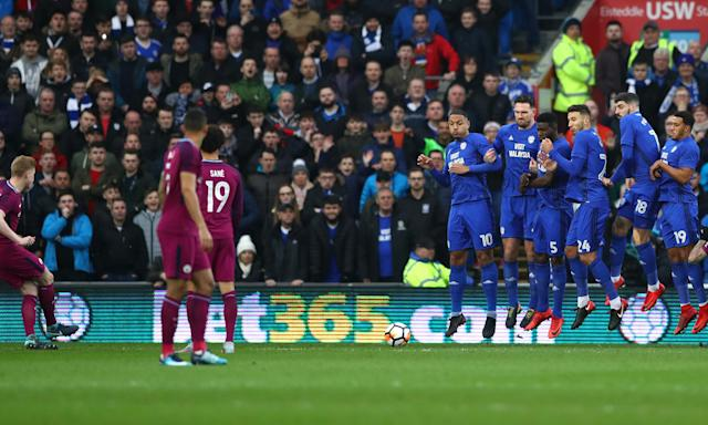 Kevin De Bruyne places his free-kick under the wall to open the scoring in the FA Cup fourth-round tie at Cardiff City Stadium.