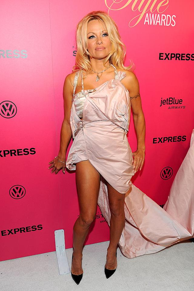 "October: Pamela Anderson   The former ""Baywatch"" babe hit the red carpet at the 6th Annual Hollywood Style Awards in this pink mess of a dress. Yes, it's held together with safety pins, and no, we don't know why she wasn't booted from the fashionable fete in that faux pas! Kristian Dowling/<a href=""http://www.gettyimages.com/"" target=""new"">GettyImages.com</a> - October 11, 2009"