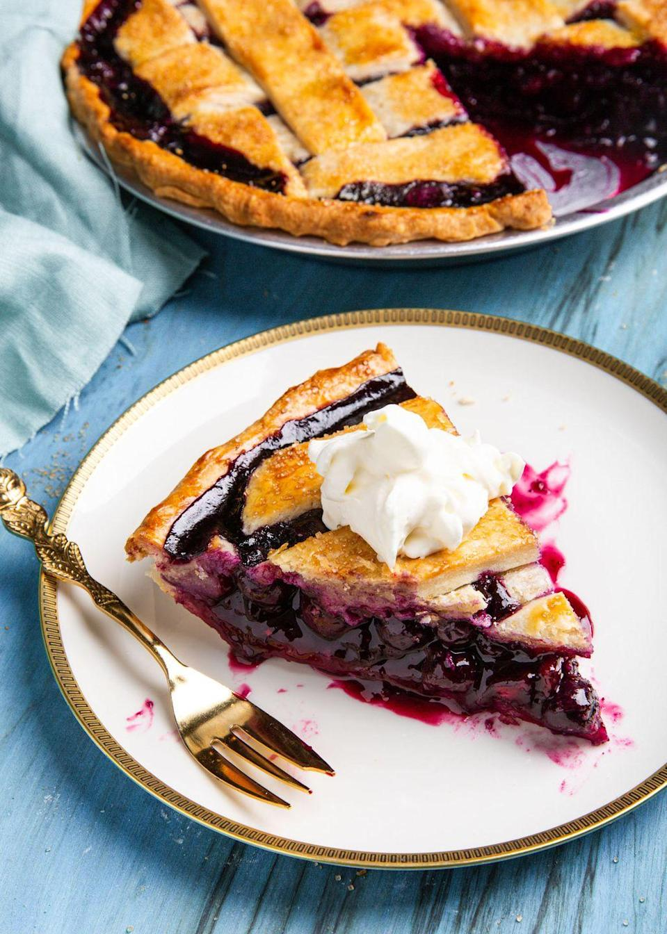 """<p>Fresh blueberry pie makes us want to sit on the back porch and enjoy the warm summer breeze.</p><p>Get the recipe from <a href=""""https://www.delish.com/cooking/recipe-ideas/a32501337/blueberry-pie-recipe/"""" rel=""""nofollow noopener"""" target=""""_blank"""" data-ylk=""""slk:Delish"""" class=""""link rapid-noclick-resp"""">Delish</a>.</p>"""