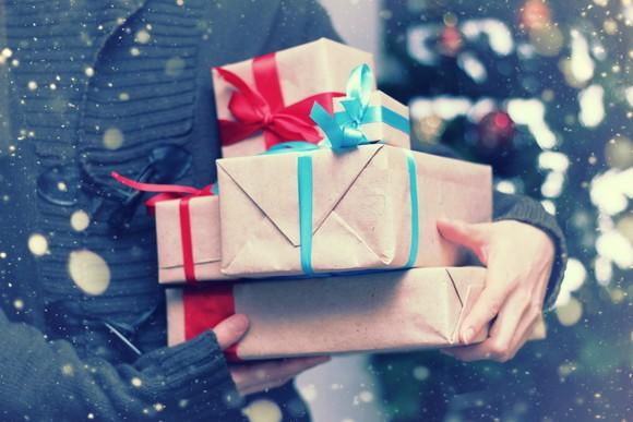 A person holds a number of presents.