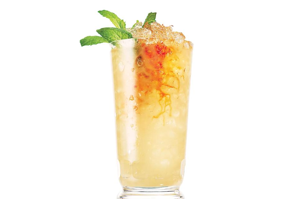 """A float of Angostura bitters gives a trippy amber color to this icy cocktail of lime juice and Jamaican rum. <a href=""""https://www.epicurious.com/recipes/food/views/rum-swizzle-56389925?mbid=synd_yahoo_rss"""" rel=""""nofollow noopener"""" target=""""_blank"""" data-ylk=""""slk:See recipe."""" class=""""link rapid-noclick-resp"""">See recipe.</a>"""