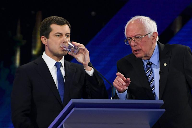 Democratic presidential hopeful Vermont Senator Bernie Sanders, right, speaks to Mayor of South Bend, Indiana, Pete Buttigieg as he drinks water during a break in the third Democratic primary debate of the 2020 presidential campaign season hosted by ABC News in partnership with Univision at Texas Southern University in Houston, Texas on Sept. 12, 2019.