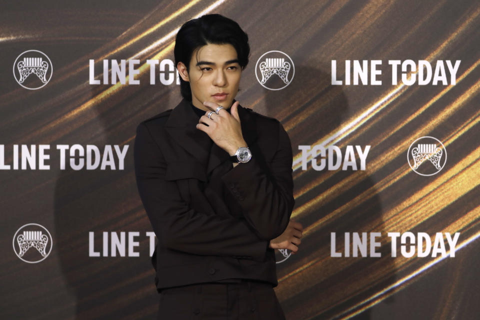 Taiwanese singer Edward Chen arrives for the 32nd Golden Melody Awards in Taipei, Taiwan, Saturday, Aug. 21, 2021. Golden Melody Awards, one of the world's biggest Chinese-language pop music annual events and postponed from June to Aug. due to the coronavirus pandemic. (AP Photo/Chiang Ying-ying)