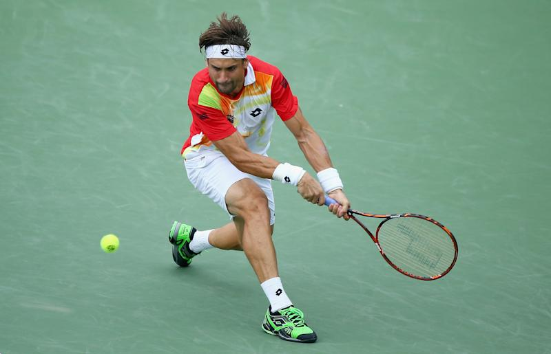 David Ferrer of Spain hits a return during his match against Julien Benneteau of France on August 16, 2014 at the Linder Family Tennis Center in Cincinnati, Ohio
