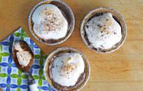 <p>Spread two scoops soft chocolate ice cream in mini graham cracker crusts. Freeze at least 1 hour or until firm. Spread about 1/4 cup marshmallow crème on each; place under broiler 2–4 minutes, or until crème turns golden brown. Top with shaved chocolate. Return to freezer until ready to serve.</p>