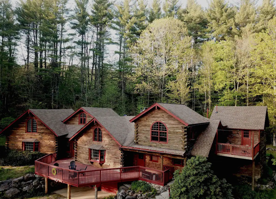 """<h2>The Berkshires, Massachusetts </h2><br><strong>Location:</strong> Tolland, MA<br><strong>Sleeps:</strong> 12<br><strong>Price Per Night:</strong> <a href=""""https://airbnb.pvxt.net/7mXjLQ"""" rel=""""nofollow noopener"""" target=""""_blank"""" data-ylk=""""slk:$1,053"""" class=""""link rapid-noclick-resp"""">$1,053</a><br><br>""""The cabin features a huge kitchen with modern appliances (two ovens!) and a dining room for entertaining large groups. An open floor plan keeps everyone together, enjoying the space in maximum comfort. There's even an office for writers or professionals who came to the Berkshires to get away from it all, but still need a decent internet connection for Zoom calls!""""<br><br><h3>Book <a href=""""https://airbnb.pvxt.net/7mXjLQ"""" rel=""""nofollow noopener"""" target=""""_blank"""" data-ylk=""""slk:Iconic Cabin In The Berkshires"""" class=""""link rapid-noclick-resp"""">Iconic Cabin In The Berkshires</a><br></h3>"""