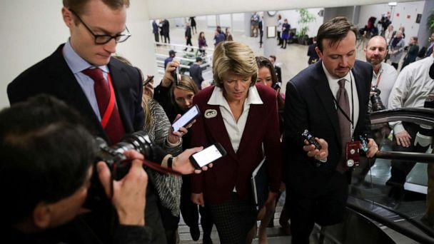 PHOTO: Senator Lisa Murkowski is surrounded by reporters as she arrives for the Senate impeachment trial of President Donald Trump at the Capitol in Washington, Jan. 28, 2020. (Jonathan Ernst/Reuters)