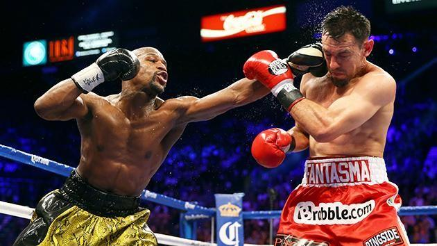 Guerrero is punched by Mayweather. Pic: Getty