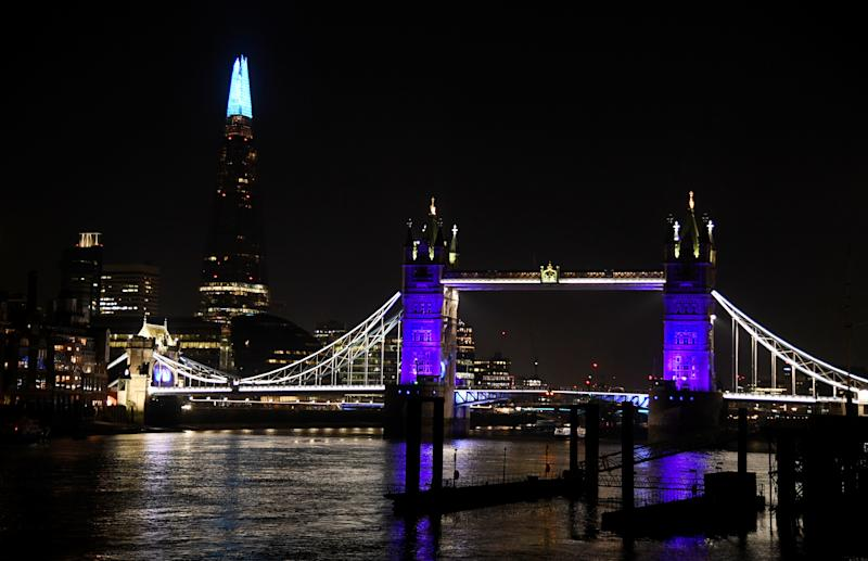 General view as Tower Bridge and the Shard are lit blue in support of the NHS, as the spread of the coronavirus disease (COVID-19) continues, London, Britain, March 26, 2020. REUTERS/Toby Melville