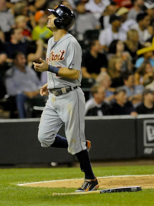 Detroit Tigers' Ian Kinsler scores on a ground-rule double hit by Toni Hunter during the fourth inning of a baseball game against the Chicago White Sox in Chicago, Friday, Aug. 29, 2014. (AP Photo/Matt Marton)