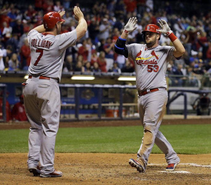 St. Louis Cardinals' Matt Adams is congratulated at home by Matt Holliday (7) after Adams hit a two-run home run during the ninth inning of a baseball game against the Milwaukee Brewers on Friday, Sept. 20, 2013, in Milwaukee. (AP Photo/Morry Gash)