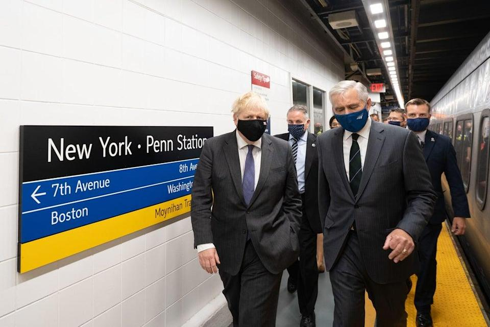 Boris Johnson (left), accompanied by Amtrak CEO William J Flynn, prepares to board a train from Penn Station in New York to Washington DC (Stefan Rousseau/PA) (PA Wire)