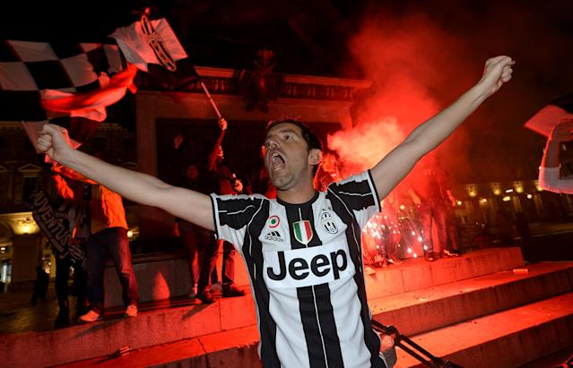 Soccer Football - Serie A - AS Roma vs Juventus - Turin, Italy - May 13, 2018. Juventus' supporter celebrates after winning the league. REUTERS/Massimo Pinca