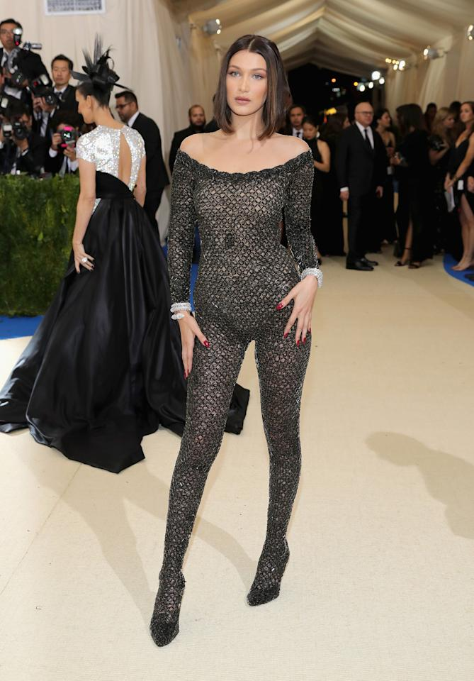 <p>The 20-year-old model stunned at the 2017 Met Gala in an Alexander Wang barely there black lace jumpsuit. (Photo: Neilson Barnard/Getty Images) </p>