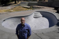 """Will Abrams stands for a photo in front of the swimming pool on the lot of his family home that was destroyed by wildfires in 2017 while interviewed in Santa Rosa, Calif., Thursday, June 24, 2021. """"I have been really disappointed,"""" Abrams said. """"The bankruptcy was sold as something that was going to hold PG&E to account, and it was not. Bankruptcy is not a process to reorganize. It is a process to divide up the dollars."""" (AP Photo/Jeff Chiu)"""