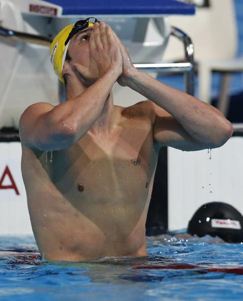 Australia's Christian Sprenger celebrates after winning the gold medal in the Men's 100m breaststroke final at the FINA Swimming World Championships in Barcelona, Spain, Monday, July 29, 2013. (AP Photo/Michael Sohn)