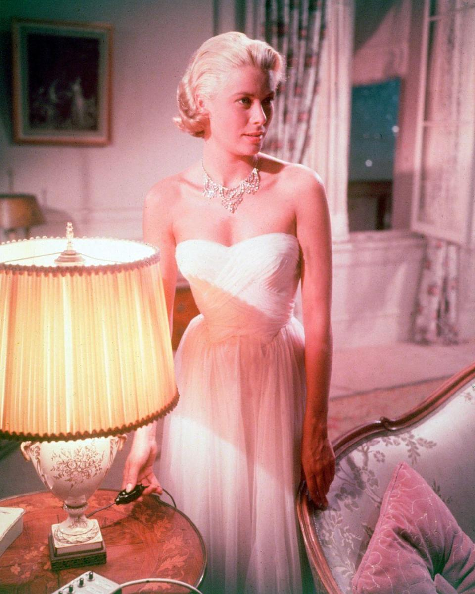 <p>Kelly shooting a scene for <em>To Catch a Thief</em>. The star, who played an oil heiress staying at a luxury hotel in Cannes, is wearing one of her most famous costumes from the film, a strapless chiffon ball gown and diamond bib necklace.</p>