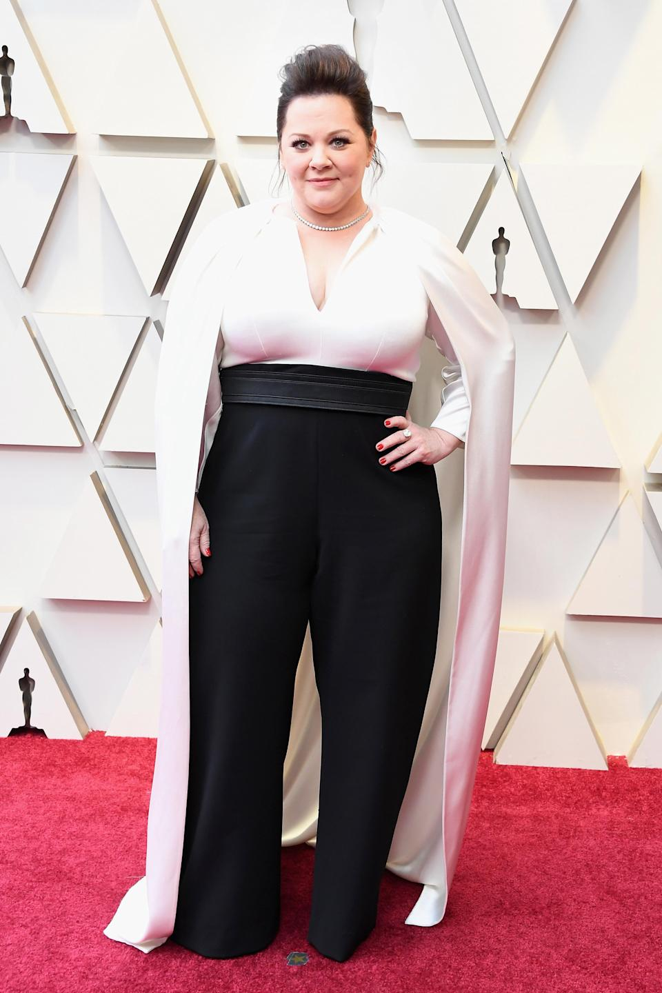 """<p>The """"Can You Ever Forgive Me?"""" actress wore a monochrome jumpsuit with cape for her first Oscars as a Best Actress nominee. <em>[Photo: Getty]</em> </p>"""