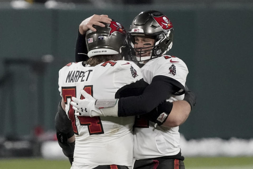 Tampa Bay Buccaneers quarterback Tom Brady (12) celebrates with Ali Marpet after winning the NFC championship NFL football game in Green Bay, Wis., Sunday, Jan. 24, 2021. The Buccaneers defeated the Packers 31-26 to advance to the Super Bowl. (AP Photo/Morry Gash)