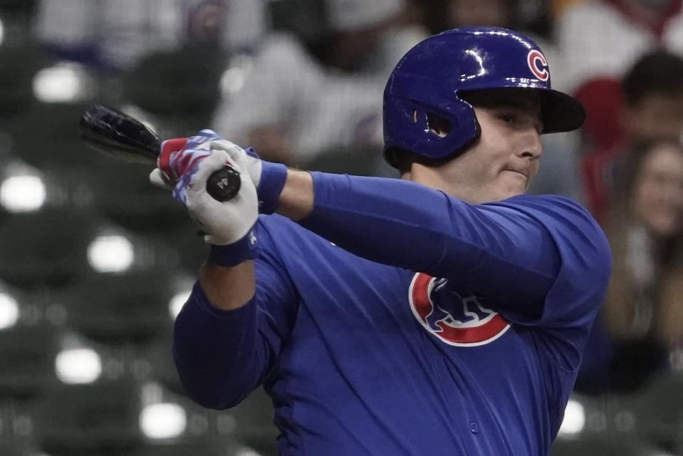 Chicago Cubs' Anthony Rizzo hits a single during the fourth inning of a baseball game against the Milwaukee Brewers Tuesday, April 13, 2021, in Milwaukee. (AP Photo/Morry Gash)