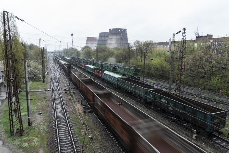In this photo taken on Monday, April 15, 2019, trains move past industrial facilities in Kryvyi Rih, in eastern Ukraine. The country votes Sunday, April 21, on whether to return President Petro Poroshenko for another 5-year term, or go with Volodymyr Zelenskiy, an actor and comedian native to Kryvyi Rih. (AP Photo/Evgeniy Maloletka)