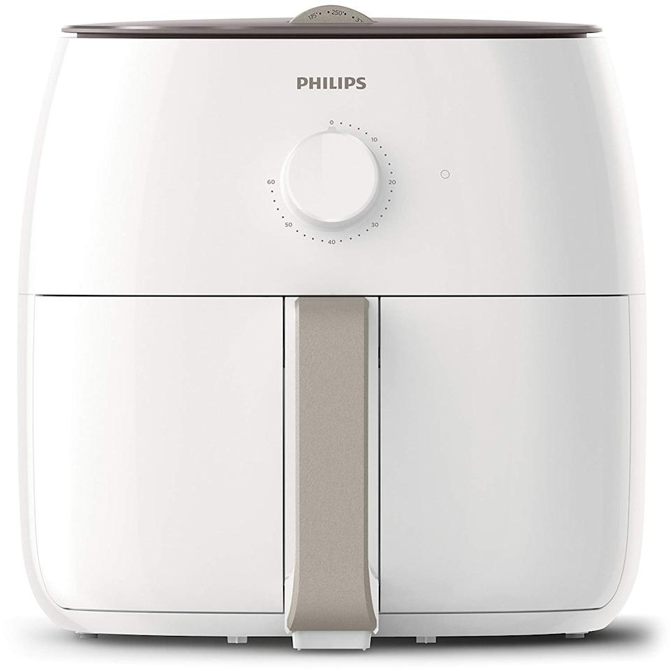 "<p>This <a href=""https://www.popsugar.com/buy/Philips-Twin-TurboStar-Technology-XXL-Airfryer-Fat-Reducer-468778?p_name=Philips%20Twin%20TurboStar%20Technology%20XXL%20Airfryer%20with%20Fat%20Reducer&retailer=amazon.com&pid=468778&price=200&evar1=moms%3Aus&evar9=46385124&evar98=https%3A%2F%2Fwww.popsugar.com%2Fphoto-gallery%2F46385124%2Fimage%2F46385131%2FPhilips-Twin-TurboStar-Technology-XXL-Airfryer-Fat-Reducer&list1=shopping%2Camazon%2Csale%2Camazon%20prime%2Csale%20shopping%2Camazon%20prime%20day&prop13=api&pdata=1"" rel=""nofollow"" data-shoppable-link=""1"" target=""_blank"" class=""ga-track"" data-ga-category=""Related"" data-ga-label=""https://www.amazon.com/Philips-HD9630-28-Collection-TurboStar/dp/B079L5XG28?ref_=Oct_DLandingS_PC_5edfdb44_0&amp;smid=ATVPDKIKX0DER"" data-ga-action=""In-Line Links"">Philips Twin TurboStar Technology XXL Airfryer with Fat Reducer</a> ($200, originally $300) will work perfectly in your kitchen, and you can have french fries every day.</p>"