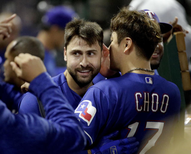 Texas Rangers' Joey Gallo celebrates with Shin-Soo Choo in the dugout after hitting a home run against the Los Angeles Angels during the third inning of a baseball game in Anaheim, Calif., Tuesday, Sept. 25, 2018. (AP Photo/Chris Carlson)