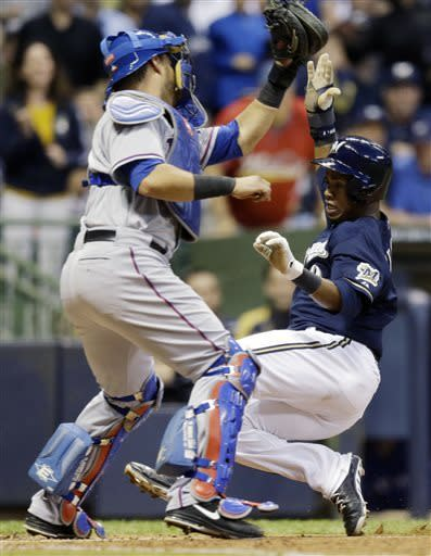 Texas Rangers catcher Geovany Soto tags out Milwaukee Brewers' Jean Segura at home during the third inning of a baseball game Wednesday, May 8, 2013, in Milwaukee. Segura tried to score from second on a hit by Aramis Ramirez. (AP Photo/Morry Gash)