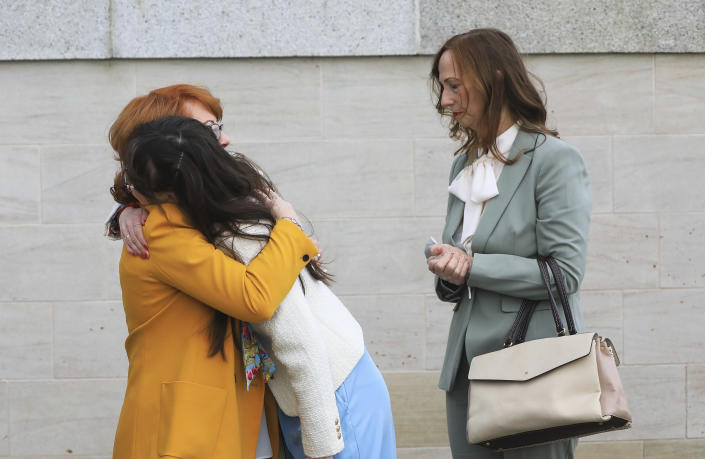 Rita Bonner, left, sister of John Laverty who was shot, with relatives arrive for the inquest into the Ballymurphy shooting, in Belfast, Northern Ireland, Tuesday May 11, 2021. The findings of the inquest into the deaths of 10 people during an army operation in August 1971 is due to be published on Tuesday. (AP Photo/Peter Morrison)