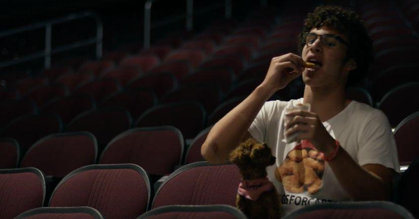 Carter went viral earlier this year thanks toa tweet he sent to Wendy's, asking how many retweets he would need to get a lifetime supply of chicken nuggets.<br /><br />The teenager appears in the video eating nuggets while wearing a #NugsForCarter t-shirt. And that pooch on his lap? It's Katy's dog... Nugget.