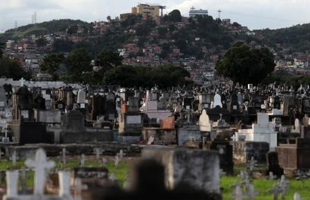 The cemetery of Inhauma is pictured with Alemao slums complex on background  in Rio de Janeiro