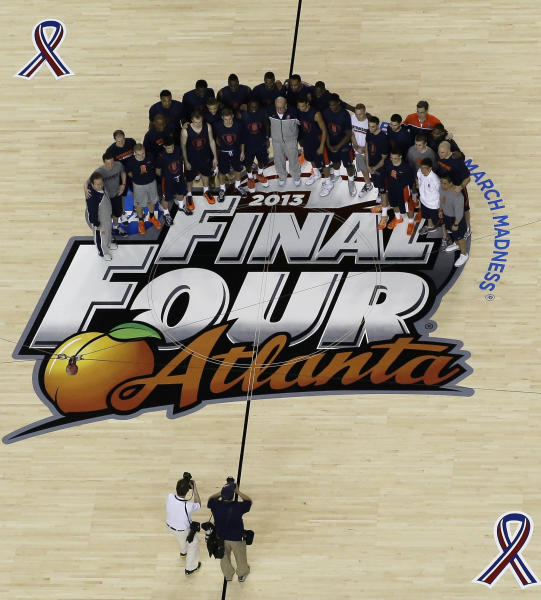Syracuse players and staff pose for a photo before practice for their NCAA Final Four tournament college basketball semifinal game against Michigan, Friday, April 5, 2013, in Atlanta. Wichita State plays Louisville in a semifinal game on Saturday. (AP Photo/Tim Donnelly)