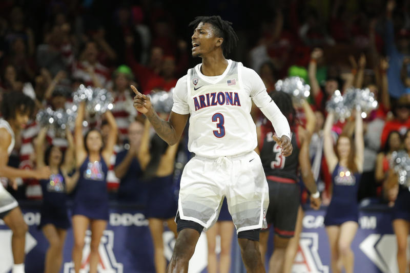 Arizona guard Dylan Smith (3) reacts after a made basket against New Mexico State in the second half during an NCAA college basketball game, Sunday, Nov. 17, 2019, in Tucson, Ariz. Arizona defeated New Mexico State 83-53. (AP Photo/Rick Scuteri)