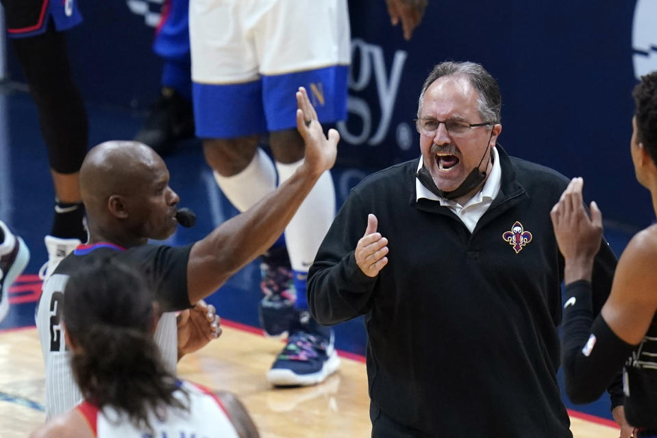 New Orleans Pelicans coach Stan Van Gundy challenges referee Dedric Taylor on a timeout call in the second half of the team's NBA basketball game against the Philadelphia 76ers in New Orleans, Friday, April 9, 2021. (AP Photo/Gerald Herbert)