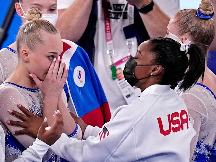 Simone Biles congratulates Russian gymnasts for their gold-medal finish in the team all-around final.