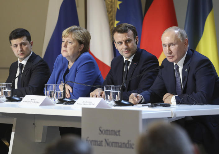 FILE - In this Dec. 9, 2019, file photo, Ukraine's President Volodymyr Zelenskiy, left, German Chancellor Angela Merkel, French President Emmanuel Macron and Russian President Vladimir Putin, right, attend a joint news conference at the Elysee Palace in Paris, France. The leaders of Russia, Ukraine, France and Germany reaffirmed their commitment to a 2015 peace deal for eastern Ukraine. (Ludovic Marin/Pool Photo via AP, File)