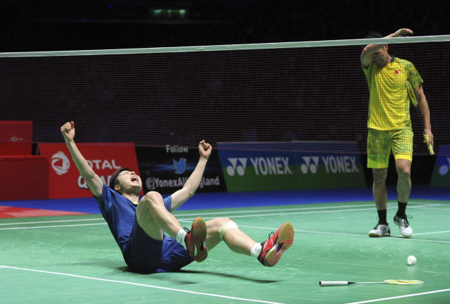 China's Shi Yuqi reacts after defeating China's Lin Dan, right, in the men's singles final match at the All England Open Badminton tournament in Birmingham, England, Sunday March 18, 2018. (AP Photo/Rui Vieira)