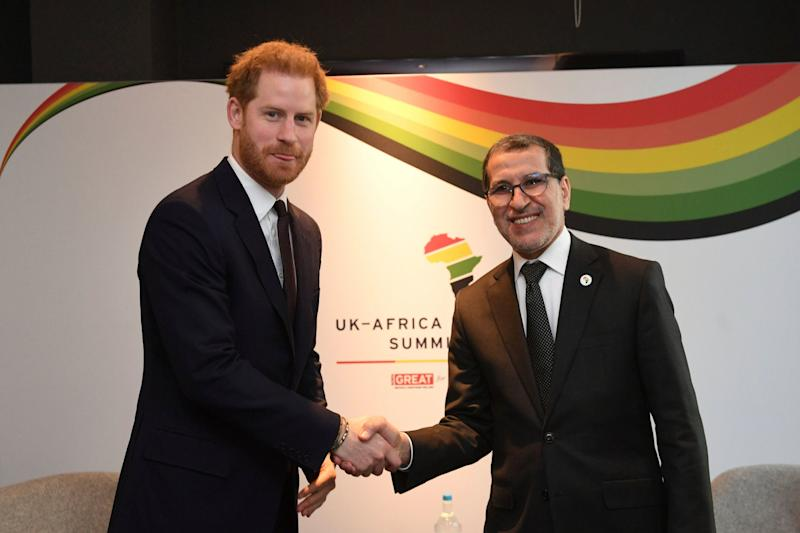 Prince Harry shakes hands with Prime Minister of Morocco Saadeddine Othmani during what could be his last royal appearance before jetting back to Canada (AP)
