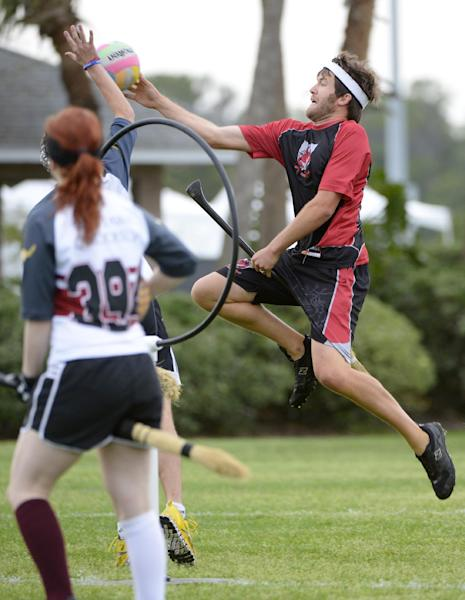 Silicon Valley Skrewts' Greg Weber, right, goes up for a shot as University of Ottawa Quidditch's Clare Hutchinson watches during a scrimmage for the Quidditch World Cup in Kissimmee, Fla., Friday, April 12, 2013.(AP Photo/Phelan M. Ebenhack)