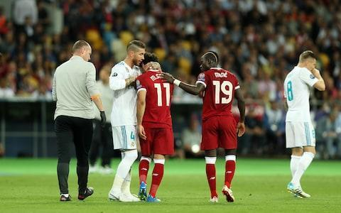 <span>Sergio Ramos apologises to Mohamed Salah as he leaves the pitch in tears </span> <span>Credit: Getty Images </span>