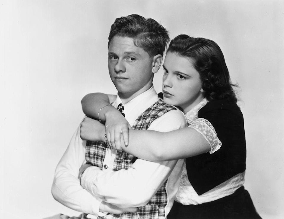 """<p>Playing the girl-next-door type, Judy co-starred with Mickey Rooney in the hit, <u><a href=""""https://www.amazon.com/Love-Finds-Hardy-Mickey-Rooney/dp/B01C568N96/ref=sr_1_1?keywords=Love+finds+andy+hardy&qid=1562443136&s=gateway&sr=8-1&tag=syn-yahoo-20&ascsubtag=%5Bartid%7C10050.g.28612488%5Bsrc%7Cyahoo-us"""" rel=""""nofollow noopener"""" target=""""_blank"""" data-ylk=""""slk:Love Finds Andy Hardy"""" class=""""link rapid-noclick-resp""""><em>Love Finds Andy Hardy</em></a></u>. They became a popular screen partnership, starring in many other movies together. </p>"""