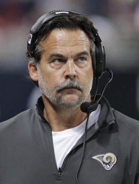 St. Louis Rams coach Jeff Fisher takes a look at the scoreboard during the second half of an NFL football game against the Seattle Seahawks on Sunday, Sept. 30, 2012, in St. Louis. The Rams won 19-13. (AP Photo/Seth Perlman)