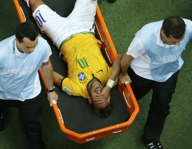 Brazil's Neymar grimaces as he is carried off the pitch after being injured during their 2014 World Cup quarter-finals against Colombia at the Castelao arena in Fortaleza