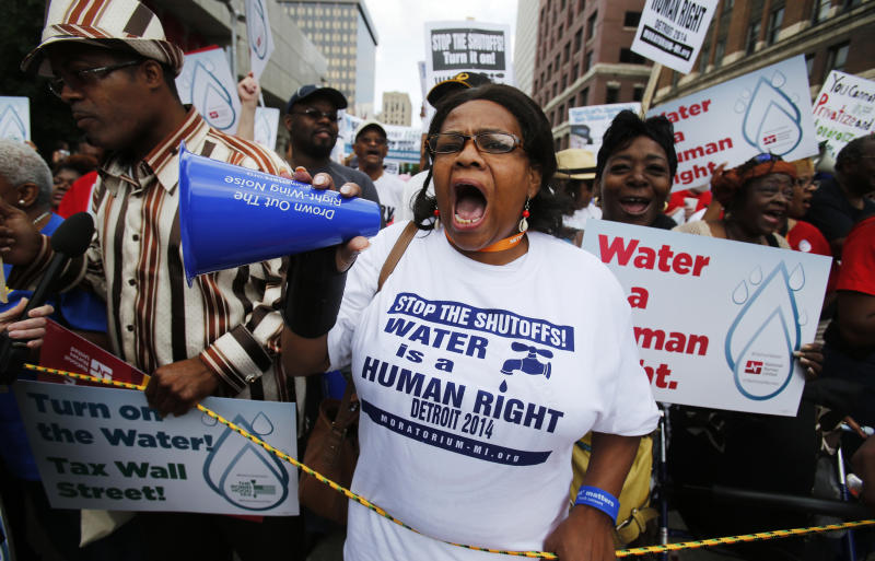 People gather to protest against the mass water shut-offs to Detroit citizens behind in their payments during a demonstration in downtown Detroit (Rebecca Cook / Reuters file)