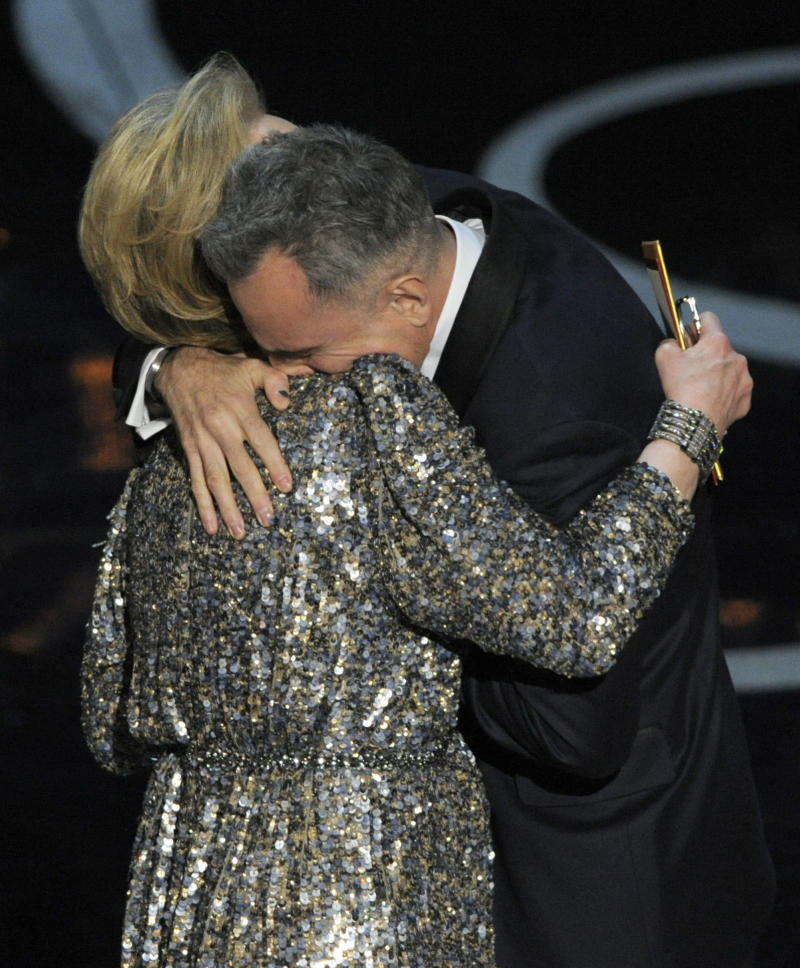 "Actress Meryl Streep, left, presents the award for best actor in a leading role to Daniel Day-Lewis for ""Lincoln"" during the Oscars at the Dolby Theatre on Sunday Feb. 24, 2013, in Los Angeles.  (Photo by Chris Pizzello/Invision/AP)"
