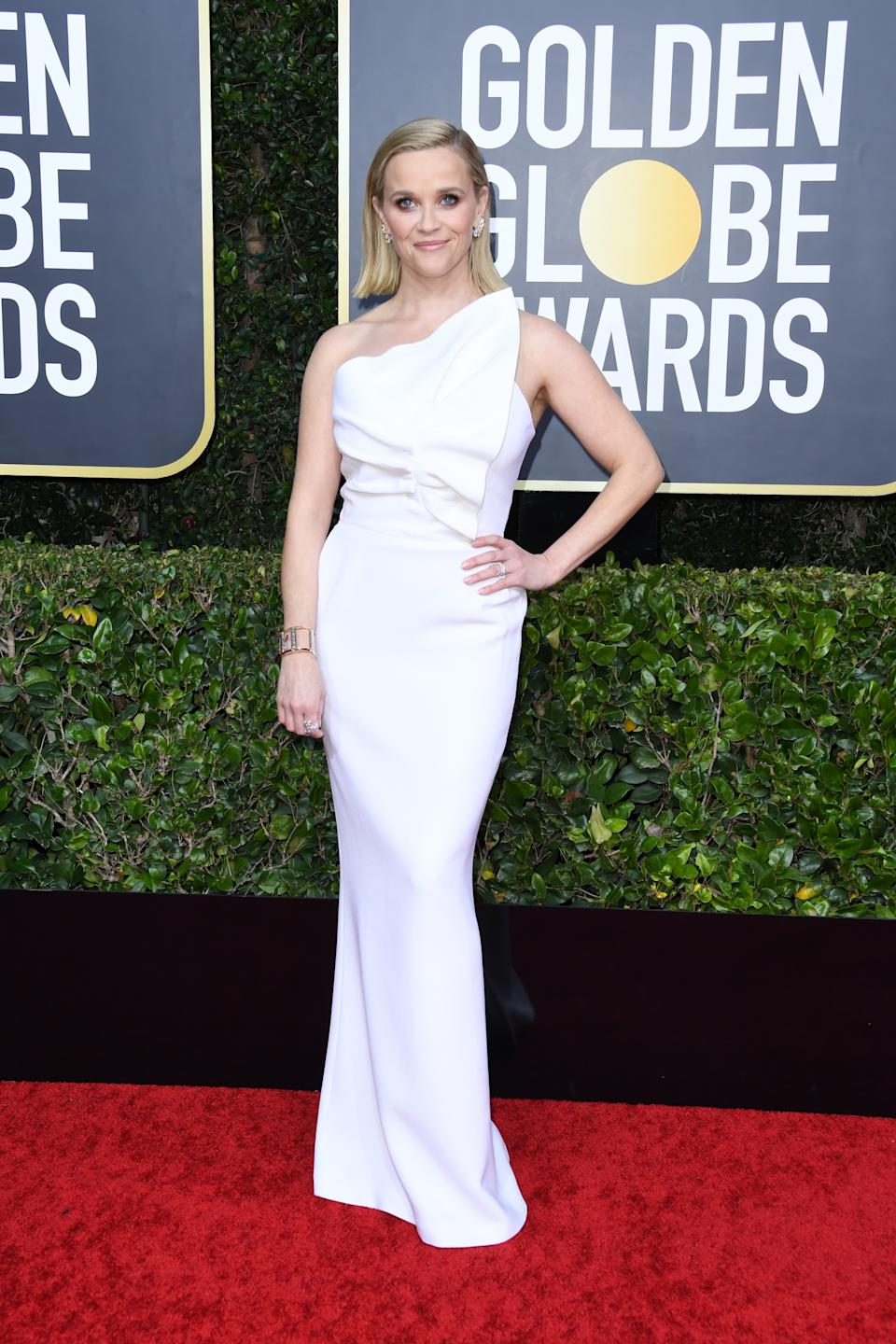 """The """"Big Little Lies"""" and """"The Morning Show"""" star opted for an asymmetrical white column gown by Roland Mouret. (Photo by Jon Kopaloff/Getty Images)"""
