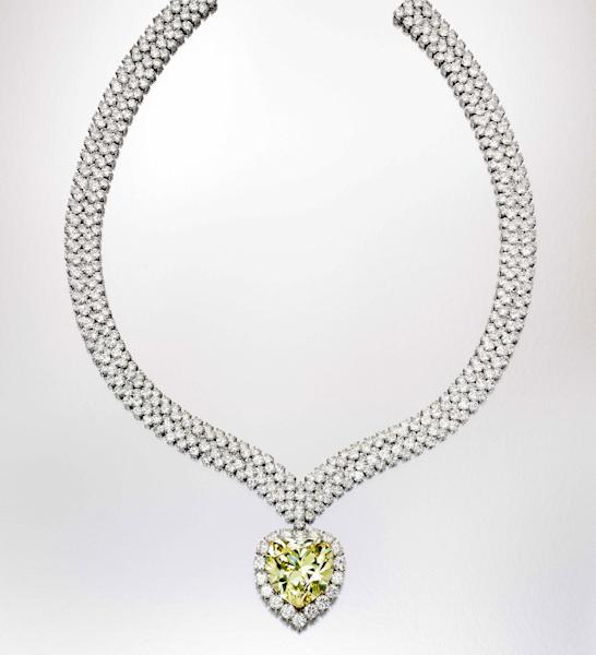 This undated photo provided by Sotheby's shows a heart-shaped yellow diamond that once belonged to the Duchess of Windsor, who wore it in a ring before it was made into this necklace. It is among a trove of jewels from the collections of Estee and Evelyn Lauder that will be auctioned to benefit breast cancer research on Dec. 5. (AP Photo/Sotheby's)