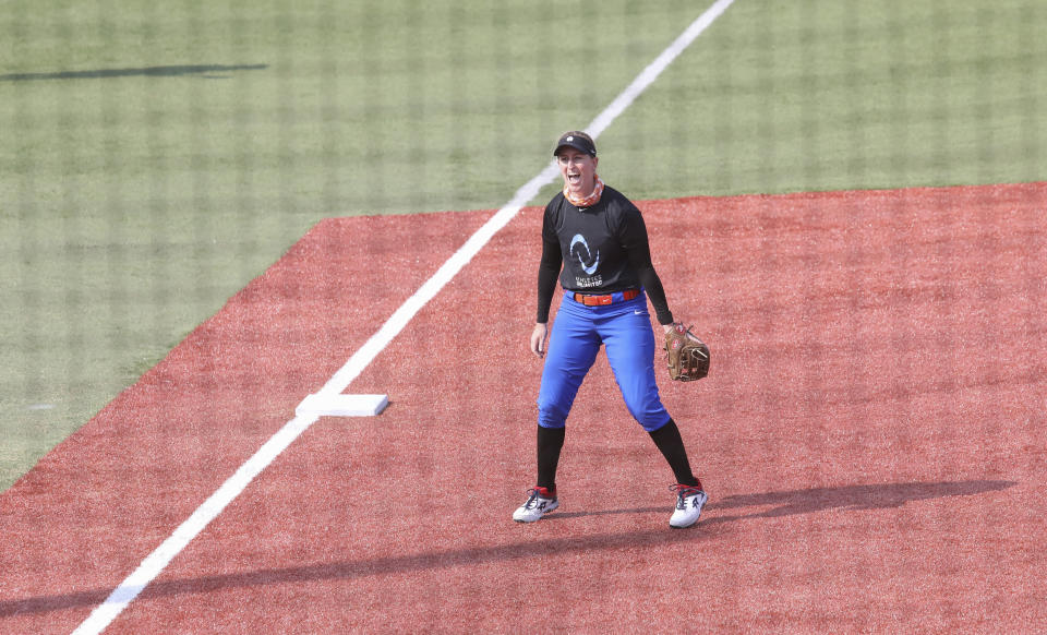 Infielder Sam Fischer reacts during Athletes Unlimited practice on Wednesday, Sept. 16, 2020, in Rosemont, Illinois. Elite players are living life in a bubble to prevent the spread of COVID during the inaugural Athletes Unlimited softball season. When they're not at the ballpark or an indoor facility across the parking lot, they are at their hotel or apartment. Everywhere else is off limits to them. (AP Photo/Teresa Crawford)