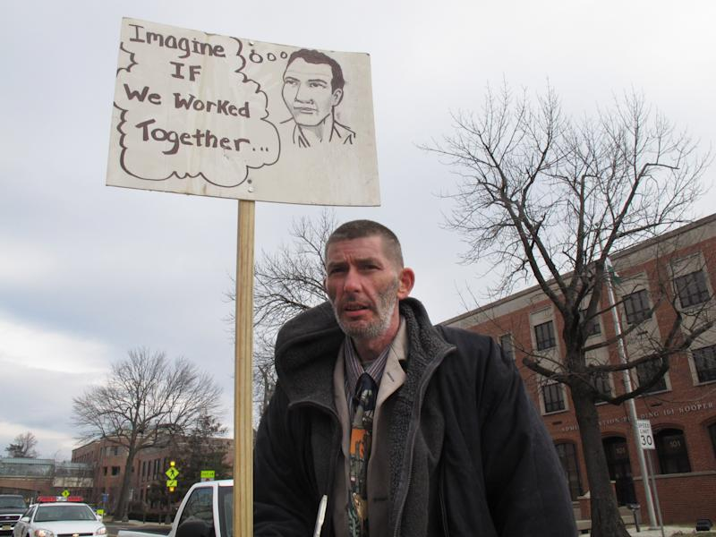 Bert Haut, a resident of the Tent City homeless encampment in Lakewood N.J., demonstrates in front of a courthouse in Toms River, N.J. on Friday, March 15, 2013. Residents of the encampment and Lakewood officials reached an agreement in principal under which none would be evicted without first being provided adequate indoor housing for at least one year. (AP Photo/Wayne Parry)